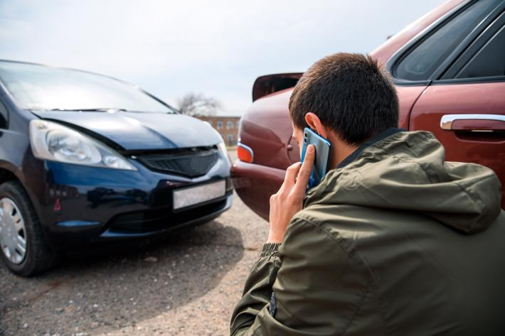 A man calling a Brockton car accident lawyer after being rear-ended.