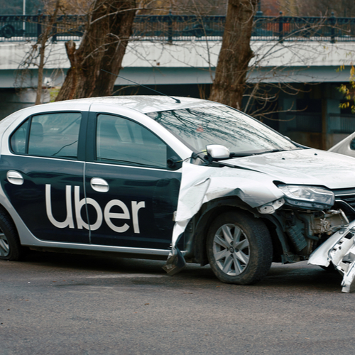 Image is of a wrecked uber car after contacting Brockton uber accident lawyer