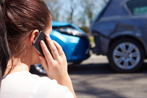 A woman calling an attorney after a car accident.