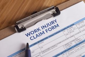 By law you cannot lose your job filing a workers' comp claim in Massachusetts