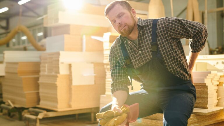 Construction worker with back injury, workers' compensation in Brockton, MA