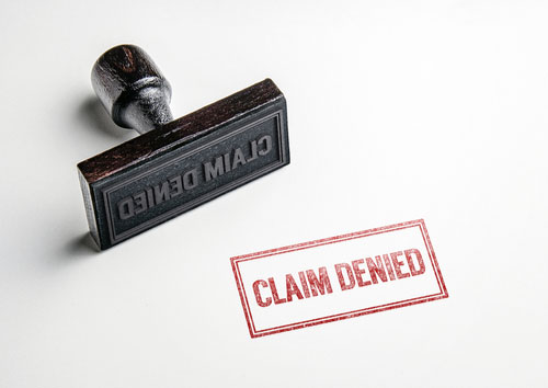 Claim denied stamped in red, Bridgewater car accident lawyer concept