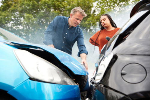 Two drivers argue over fault after car accident in Walpole, MA.