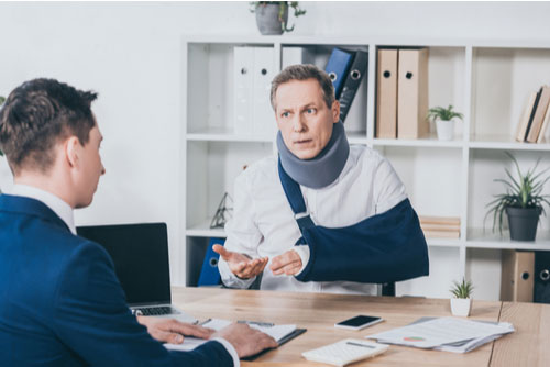 Walpole personal injury lawyer and injured man discuss attorney fees.