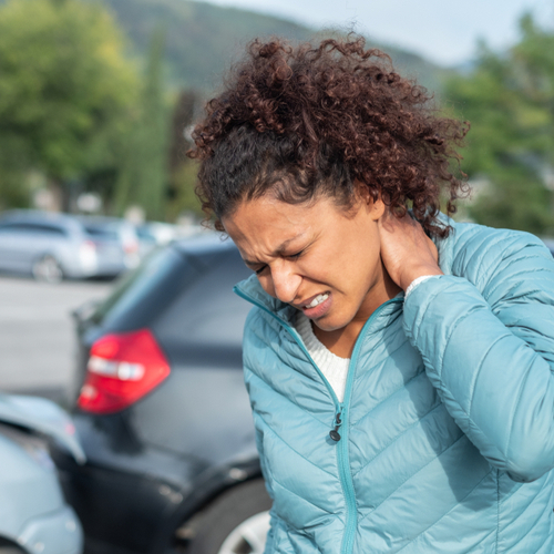 This is an image of a woman who injured her neck in an accident and will call a Norwood personal injury lawyer